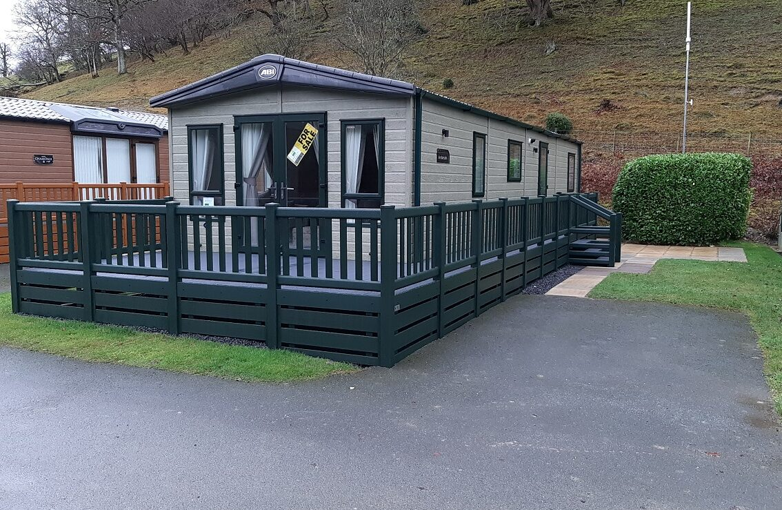This Beautiful Lodge comes with a complete wrap around color matching UPVC deck
